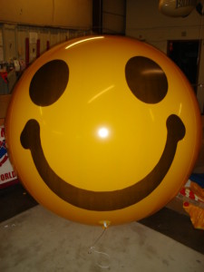 yeloow color helium balloon with smiley face artwork